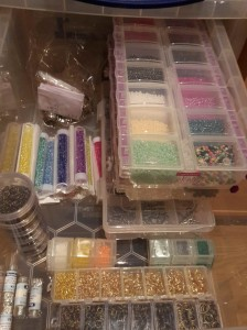 Here I keep all my small beads and small charms as well as most of my findings